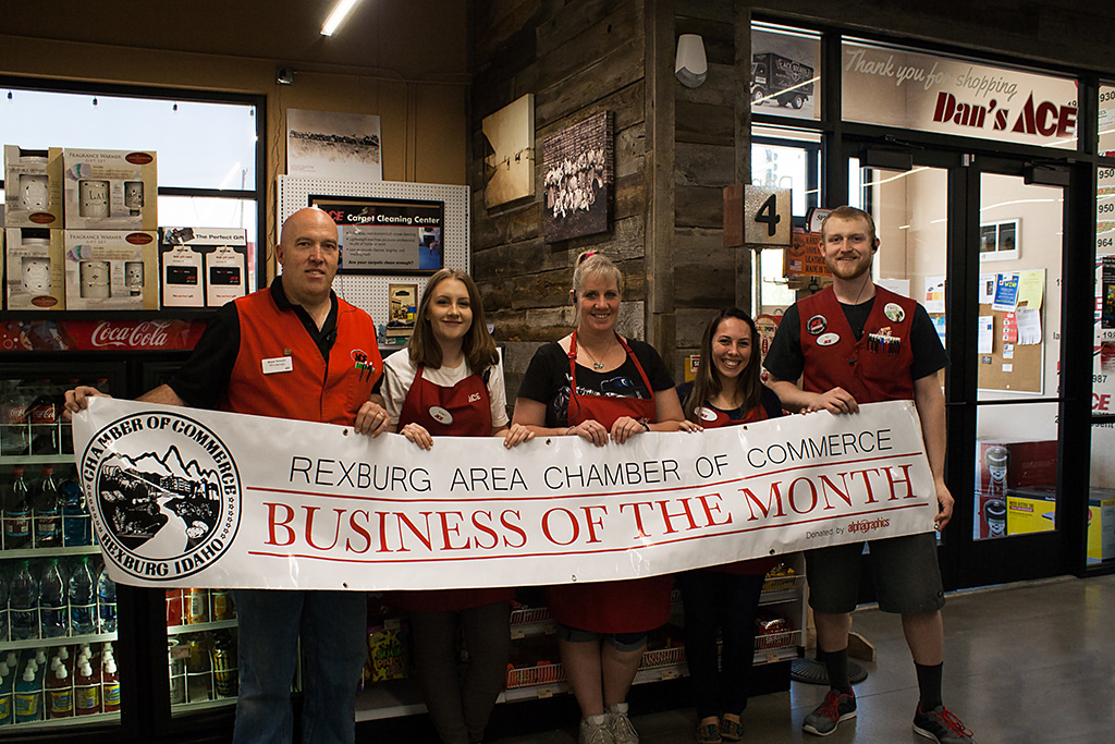 Dan's Ace Hardware employees holding business of the month banner.